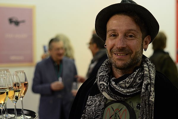 16 King of Beasts director Tomer Almagor takes in the spirit of the Fest at the Exhibition Reception.